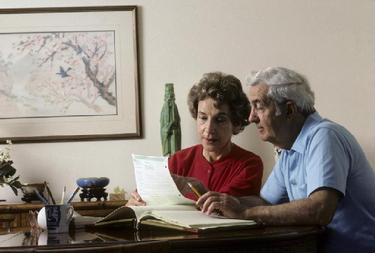 couple executing estate planning documents